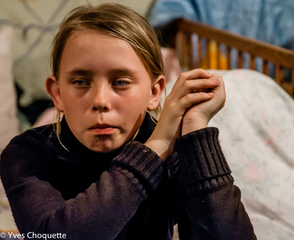 Natasha, 11 years old, severely traumatized. She's been living in a squatted bunker with her family since August 2014, in the city of Petrovsky.                 She screams when she hears an unfamiliar noise. From my photo series My Life is a Bunker