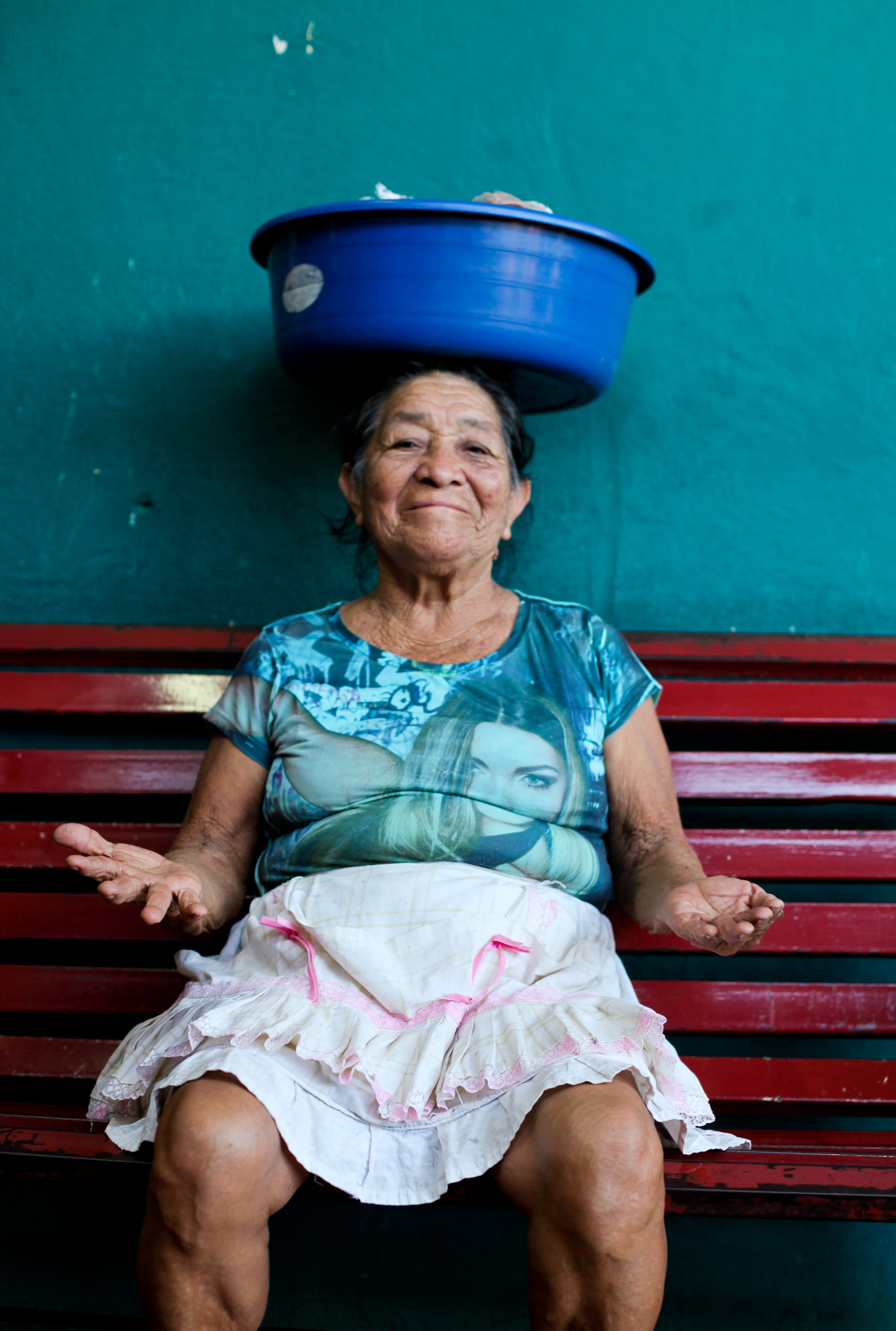 Laura's work focuses on portraiture. This image shows a market seller taking a break in Nicaragua.