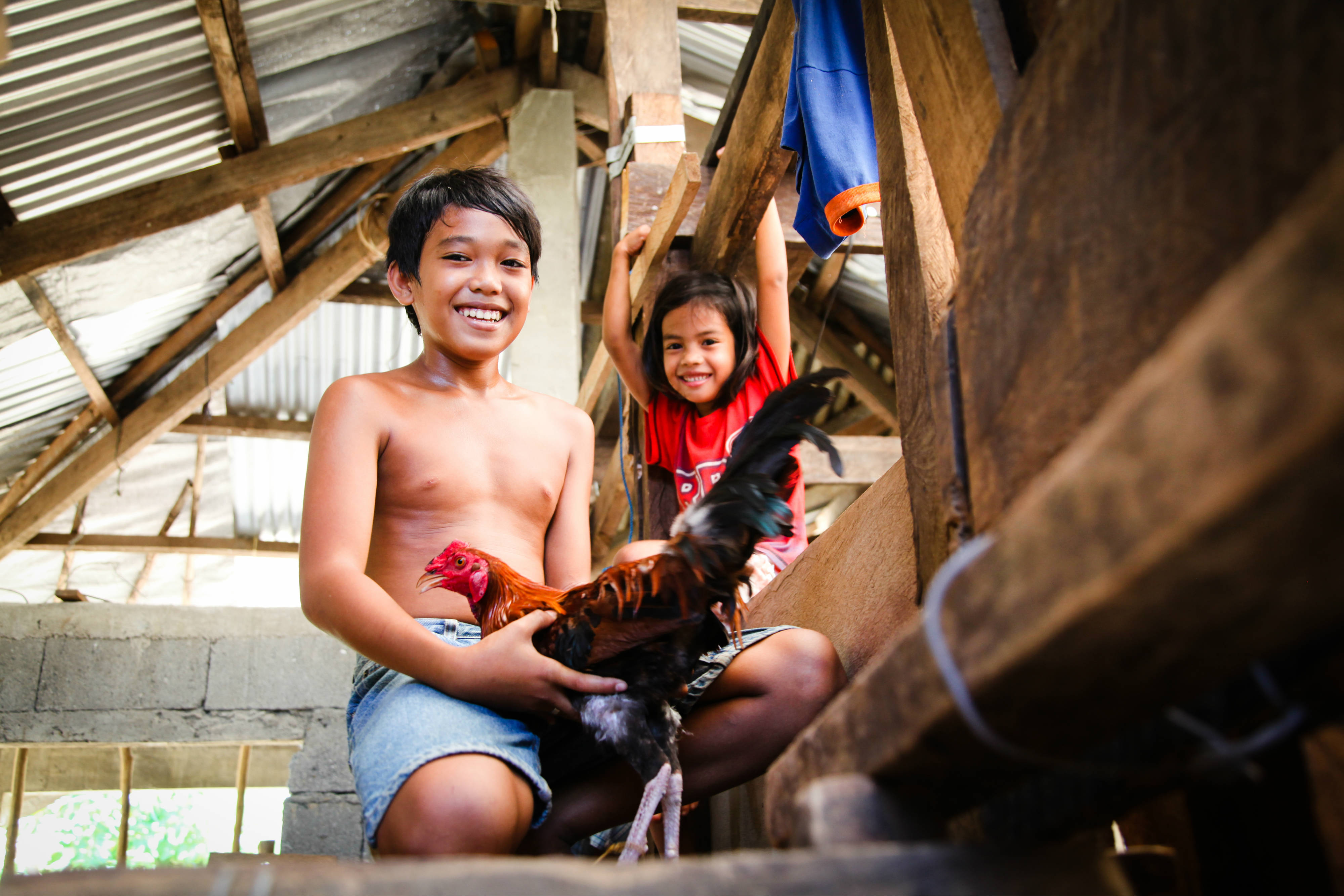 On her most recent assignment Laura went to the Philippines with charity All We Can to look at the recovery on the islands of Samar and Leyte from 2013's Typhoon Haiyan. Here a family that have received support from All We Can's partner Medair enjoy their new home.