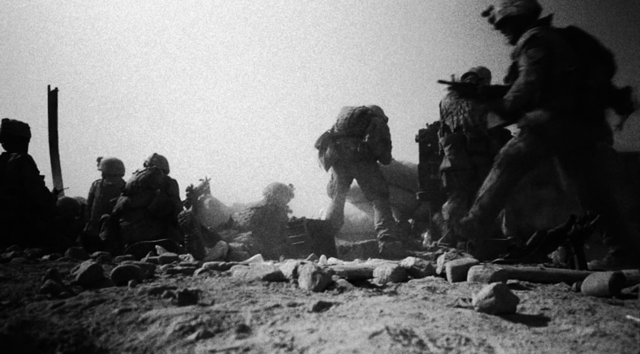 US Troops hold down a position against the Taliban in Helmand during operation Panther Claw in 2009. Barack Obama raised the amount of troops in the south to 40,000 to help clear the insurgency and assist the British army in Helmand. Two US soldiers were injured and one killed in this day in Marjah. © Jacob Simkin.