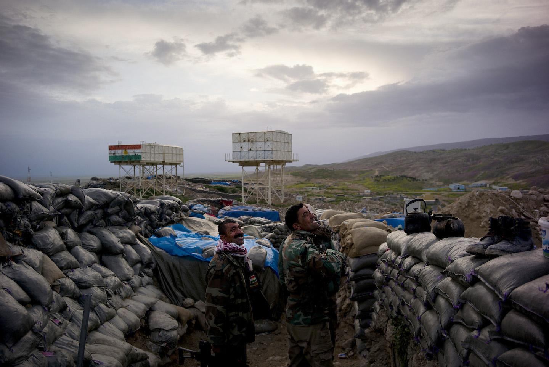 Peshmerga fighters watch American air support hit targets against an ISIS location in Sinjar. Kurdistan, Iraq, 2015. © Jacob Simkin.
