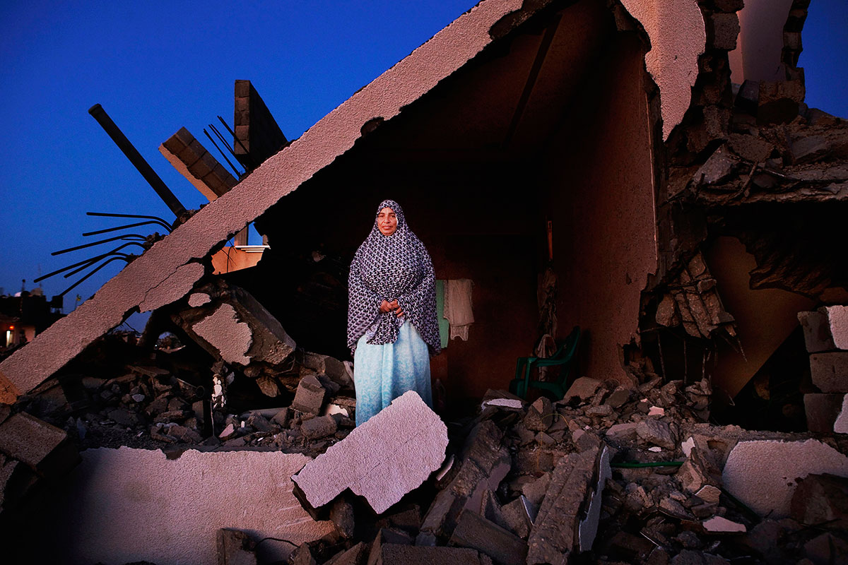 Sobheya Hamid Abu Mutlag, 59, poses at her home in Khan Yunis, destroyed by Israeli airstrike during the 2014 summer's 50-day war between Israel and Hamas. Despite the serious damage, she cannot leave, since there is no place else to move, or too expensive for the rent after the war. Khan Yunis, Oct/ 04/ 2014.
