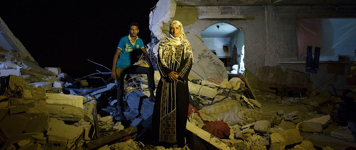 Safia Mohamed Al-Najar, 47, and her 25 year old son Fadi Al-Najar saw their home in Khan Yunis destroyed by artillery and airstrike during the summer's 50-day war between Israel and Hamas. Despite the fact the house is in the dangerous condition, they have to stay, since there is no place else for them to move, or too expensive to do so. And virtually no body has come to help them yet. The son was supposed to marry soon, but it was canceled. Khoza'a in Khan Yunis, Oct/10/2014