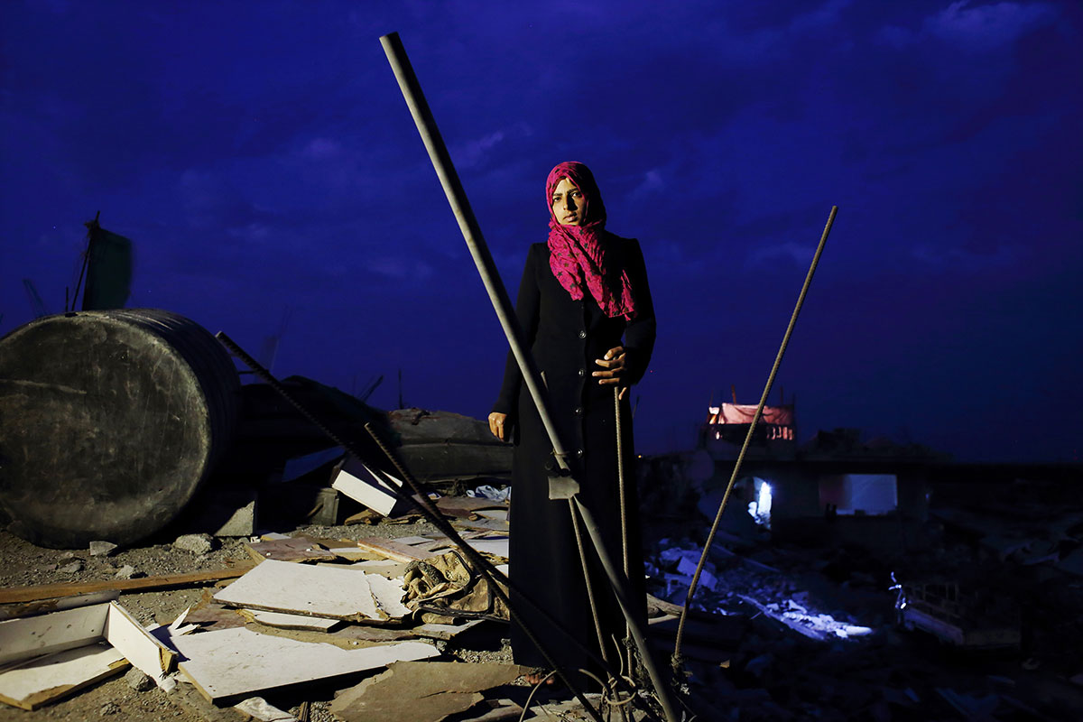 Eman Al-Najar, 23, saw her home in Khoza'a in Khan Yunis destroyed and her brother killed by Israel Defense Forces during the summer's 50-day war between Israel and Hamas. She still stays in a tent with her family on the site of this damaged home. Despite the difficulty, she cannot leave, since there is no other place to move, or too expensive. And virtually nobody has come to help yet. Oct/ 10/ 2014