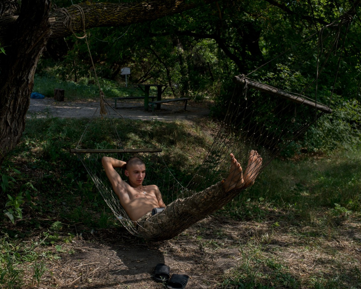 A volunteer military soldier relaxes at a base in E. Ukraine. Timothy Eastman