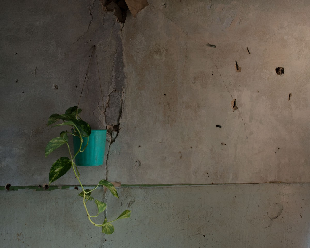 Marks from shrapnel inside a home in the village of Avdiivka. Timothy Eastman