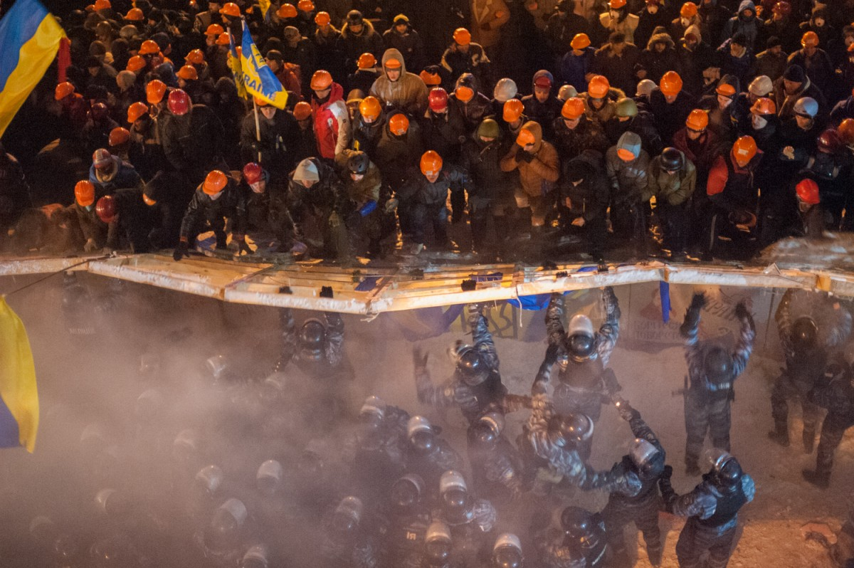 11.12.2013. Police of Special Unit Berkut try to break down the barricades on Independence Square in Kiev.